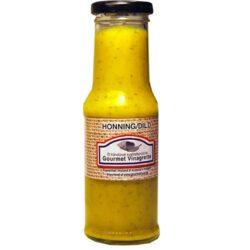 dressing med honning og dild på glasflaske